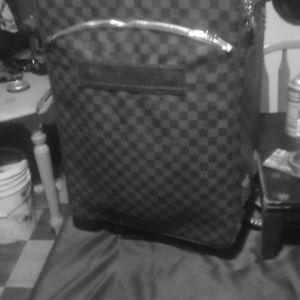 Louis Voitton rolling carry on and Louis Voitton h